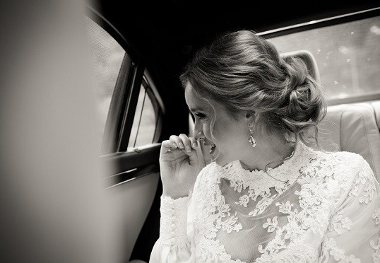 bride in her chauffeur wedding car